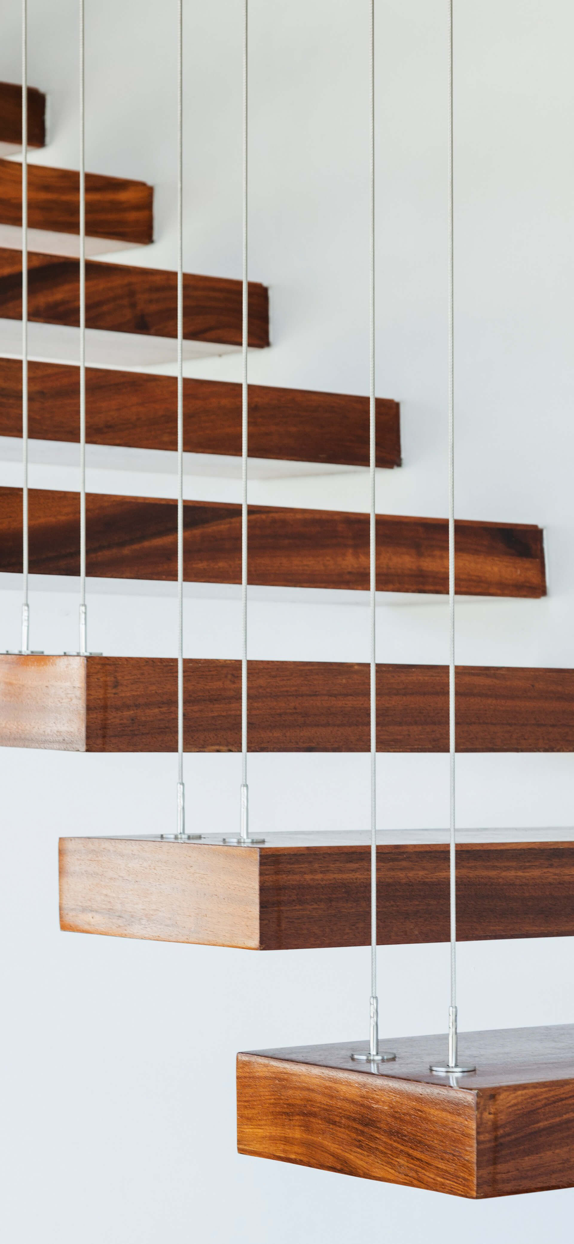Floating wooden stairs being suspended by wires